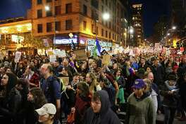 Anti-Donald Trump protestors down 2nd Avenue through downtown Seattle, Wednesday evening, Nov. 9, 2016.