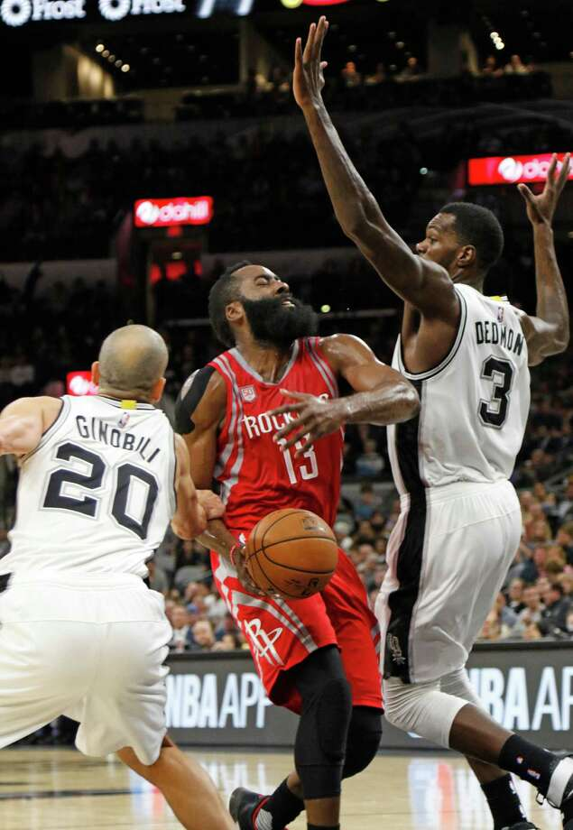 SAN ANTONIO,TX - NOVEMBER 09: James Harden #13 of the Houston Rockets is fouled as he drives past Manu Ginobili #20 of the San Antonio Spurs and Dewayne Dedmon #3 of the San Antonio Spurs at AT&T Center on November 9, 2016 in San Antonio, Texas.  NOTE TO USER: User expressly acknowledges and agrees that , by downloading and or using this photograph, User is consenting to the terms and conditions of the Getty Images License Agreement. Photo: Ronald Cortes, Getty Images / 2016 Getty Images