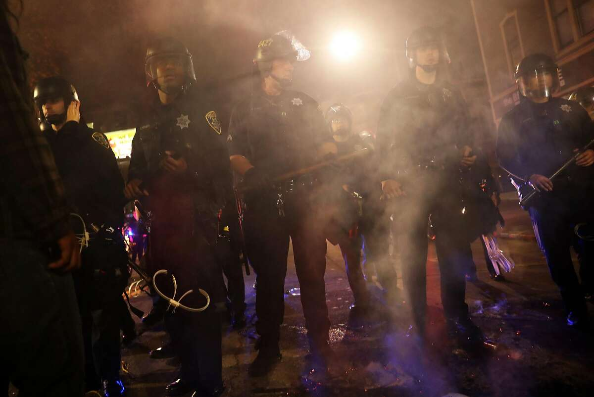 Oakland Police advance on anti Donald Trump protesters during a march in Oakland, Calif., on Wednesday, November 9, 2016.