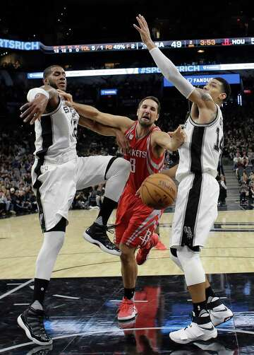 e4dc2d78e8e 2of3Houston Rockets forward Ryan Anderson (3) loses control of the ball as  he drives to the basket against San Antonio Spurs forward LaMarcus Aldridge  (12) ...