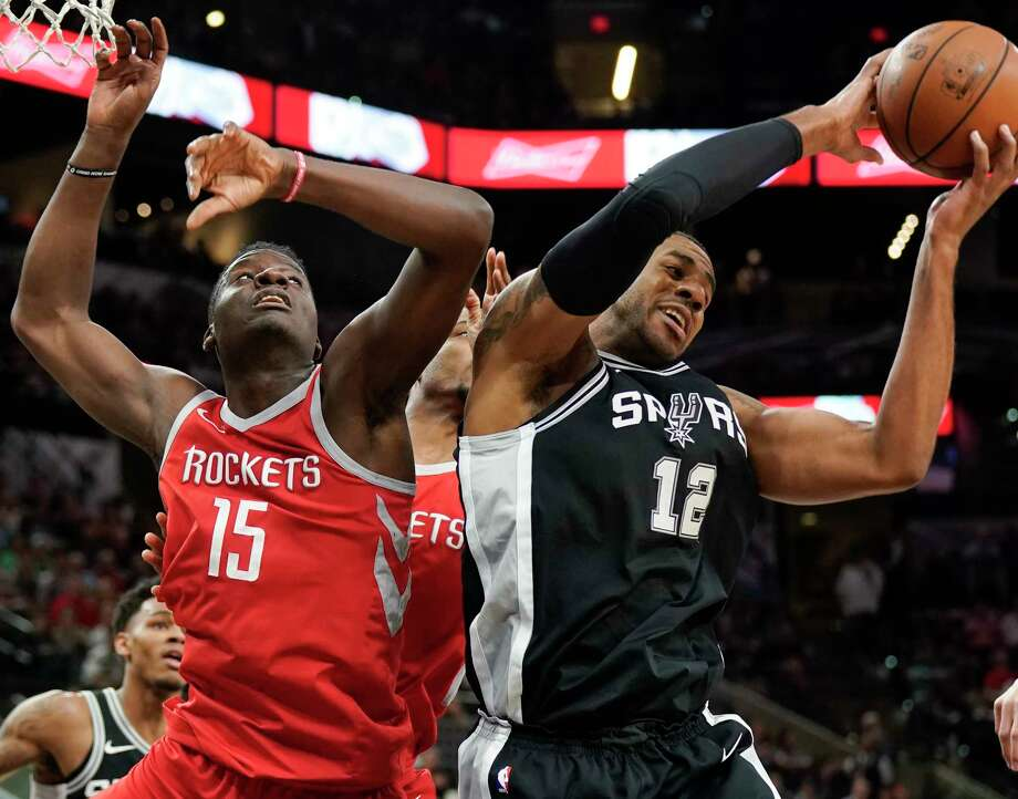 San Antonio Spurs' LaMarcus Aldridge (12) grabs the rebound away from Houston Rockets' Clint Capela during the first half of an NBA basketball game, Sunday, April 1, 2018, in San Antonio. (AP Photo/Darren Abate) Photo: Darren Abate, Associated Press / FR115 AP
