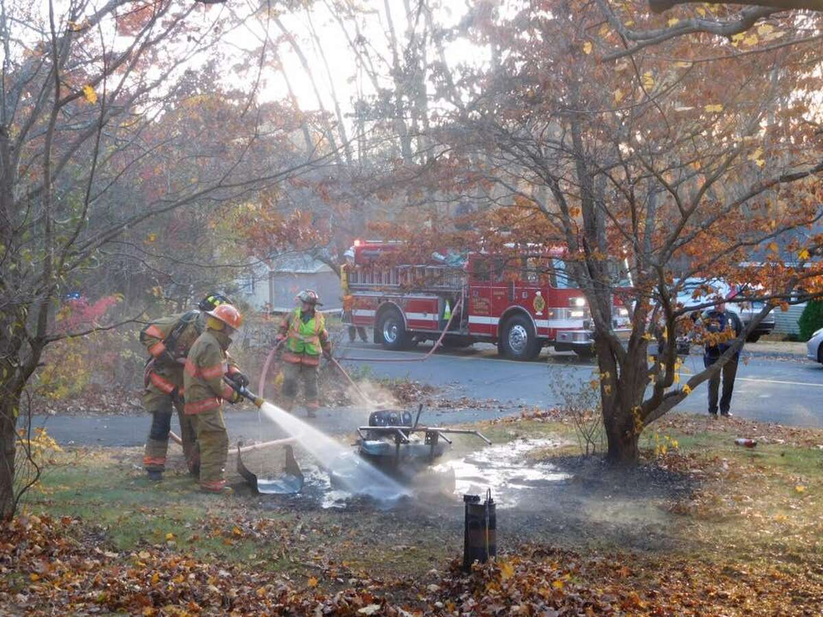 Oxford firefighters hose down an Oxford riding tractor that caught fire on Wednesday, Nov. 9, 2016.
