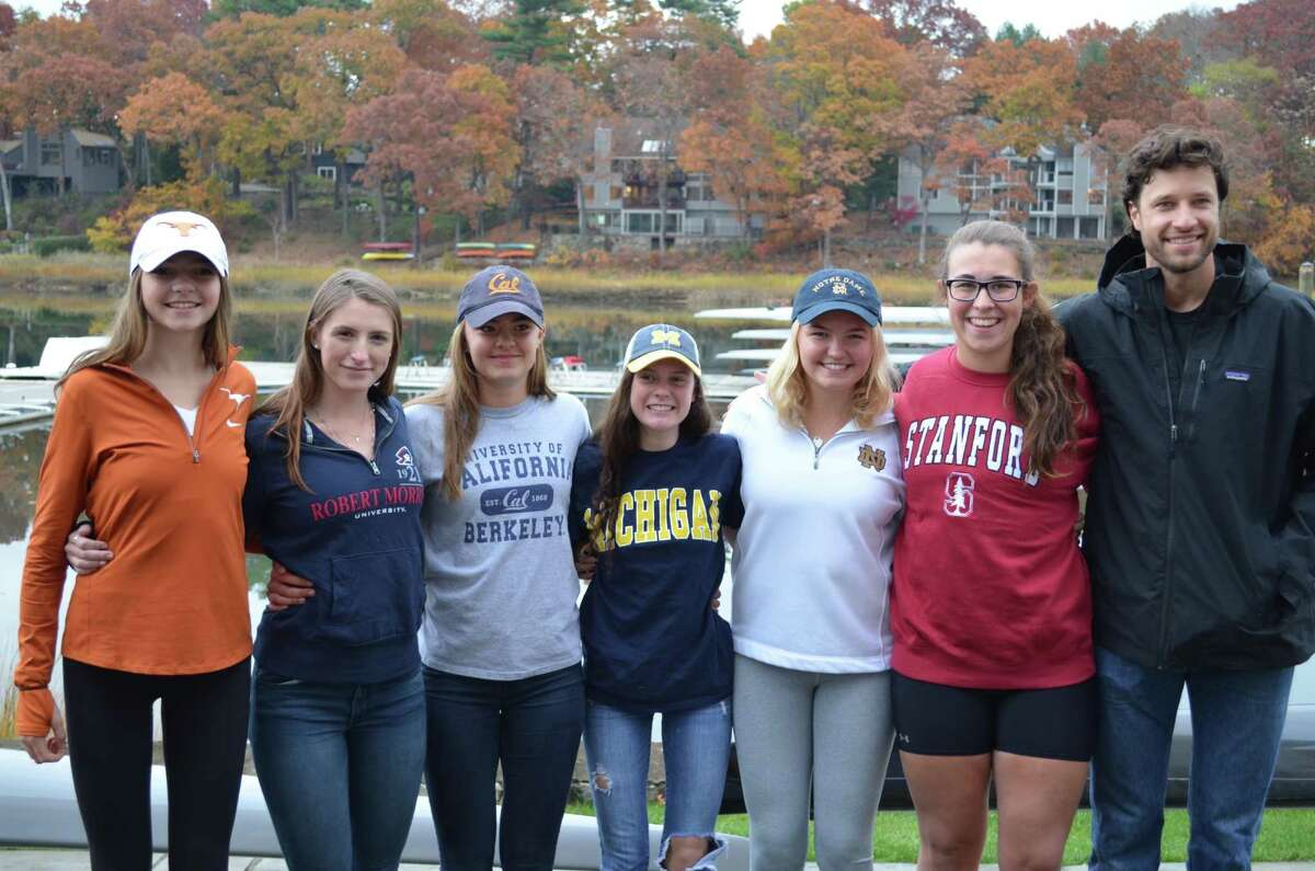 Six Saugatuck Rowing Club athletes signed Letters of Intent to row at colleges next year.From left:Sophie Pendrill, Scarsdale, University of Texas at Austin; Katelyn DeAgro, Westport/Staples, Robert Morris University; Imogen Ratcliffe, Westport/Staples, U.C. Berkeley; Charlotte Powers, Fairfield, University of Michigan; Kate Johnson, Westport/Staples, University of Notre Dame; Grace McGinley, Westport/Staples, Stanford University; and Saugatuck Rowing Club Junior Girls Head Coach Gordon Getsinger.