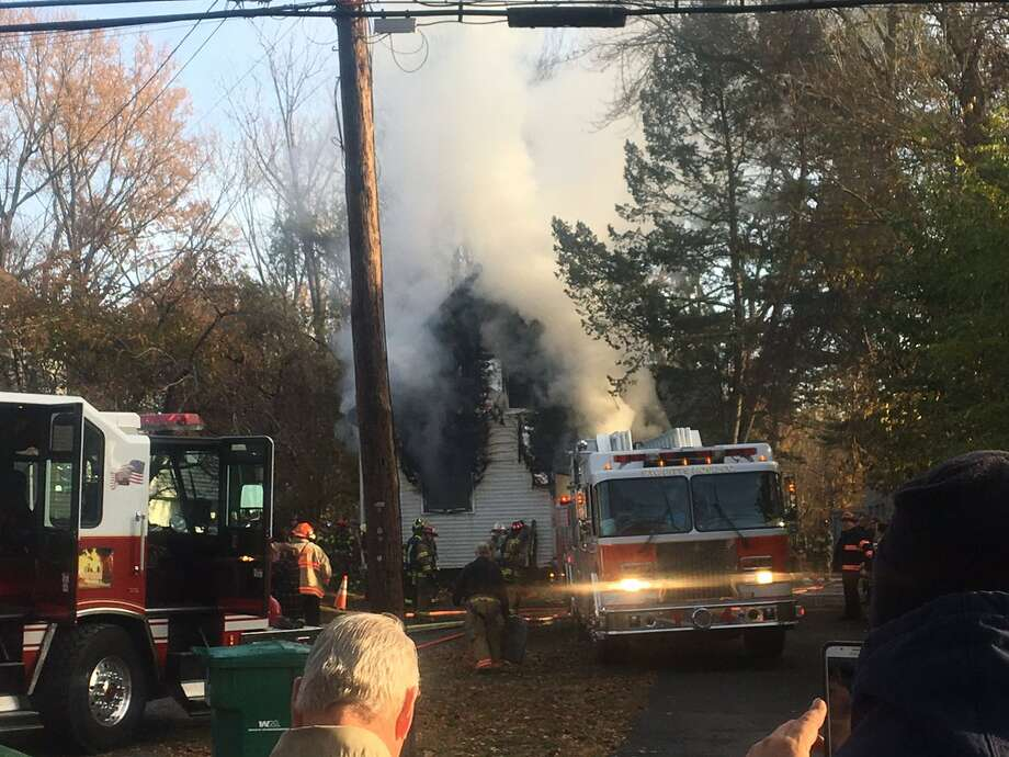 Crews are fighting a smoky fire Thursday morning, Nov. 10, 2016, at 45 Sand Creek Road, Colonie. (Larry Rulison/Times Union)