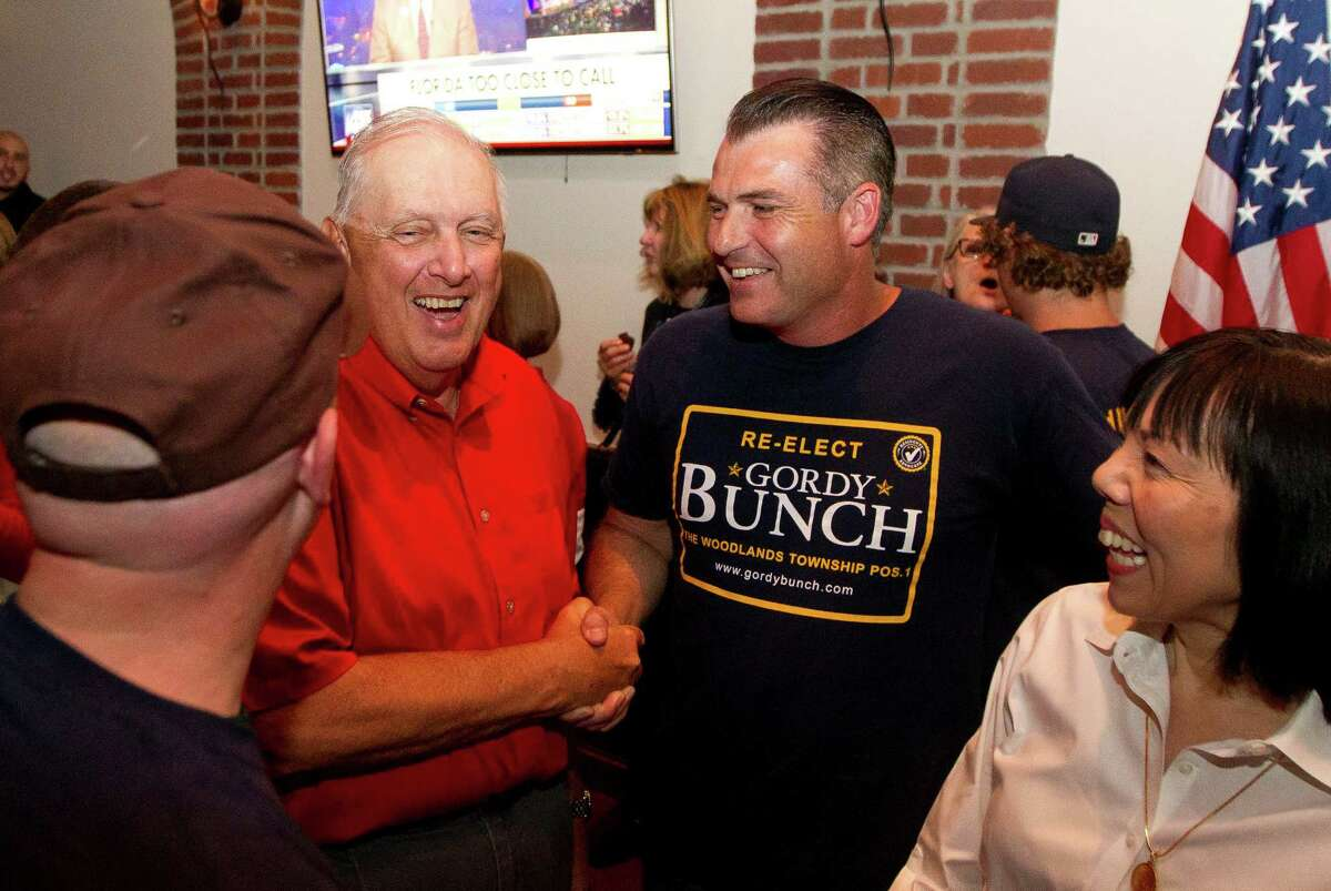 Bruce Rieser, second from left, laughs with Gordy Bunch during an election party at Black Walnut Cafe Tuesday in The Woodlands. Rieser is seeing election for position 4 for The Woodlands Township, while Bunch is seeking re-election for position 1.