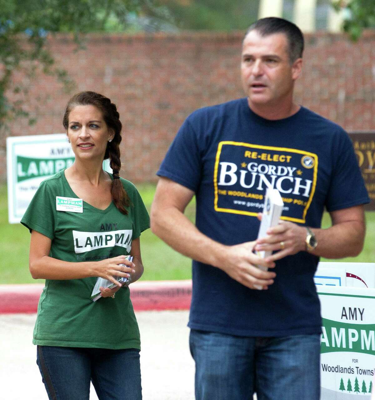 Gordy Bunch, incumbent candidate for The Woodlands Township Position 1, is seen along fellow candidate Amy Lampman as the two campaign outside the voting location at Galatas Elementary Tuesday, Nov. 8, 2016, in The Woodlands. Bunch and Lampman are running for Position 1 along with Bob Leilich.