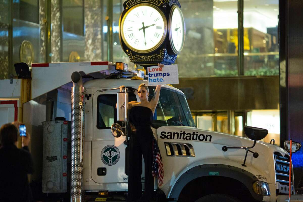 Musician Lady Gaga stages a protest against Republican presidential nominee Donald Trump on a sanitation truck outside Trump Tower in New York City after midnight on election day November 9, 2016. Donald Trump stunned America and the world, riding a wave of populist resentment to defeat Hillary Clinton in the race to become the 45th president of the United States. The Republican mogul defeated his Democratic rival, plunging global markets into turmoil and casting the long-standing global political order, which hinges on Washington's leadership, into doubt.