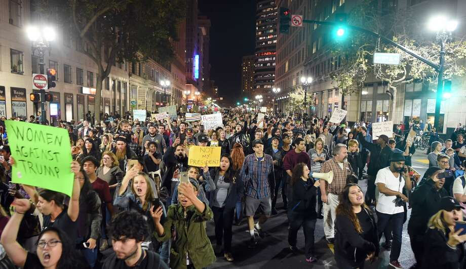 People march and shout during an anti-Trump protest in Oakland, California on November 9, 2016. Thousands of protesters rallied across the United States expressing shock and anger over Donald Trump's election, vowing to oppose divisive views they say helped the Republican billionaire win the presidency. Photo: JOSH EDELSON/AFP/Getty Images