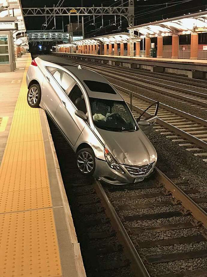 A driver who suffered a medical emergency drove hits car on the railroad tracks at the West Haven train station early Thursday, police said. There were no other injuries, police said. Photo: West Haven Police Department