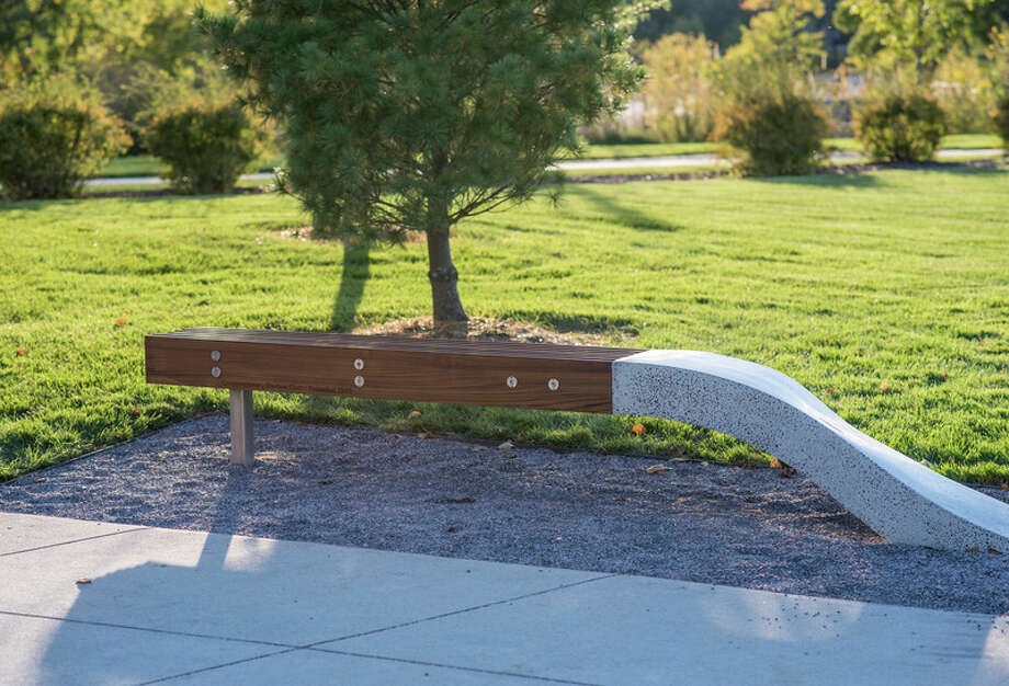 This commemorative bench was constructed using steel, teak wood and concrete by artisan Erick Forshee of the Fisher Companies. He devoted more than 200 hours in its construction. The blue pea-gravel at its base is also embedded in the polished concrete base.
