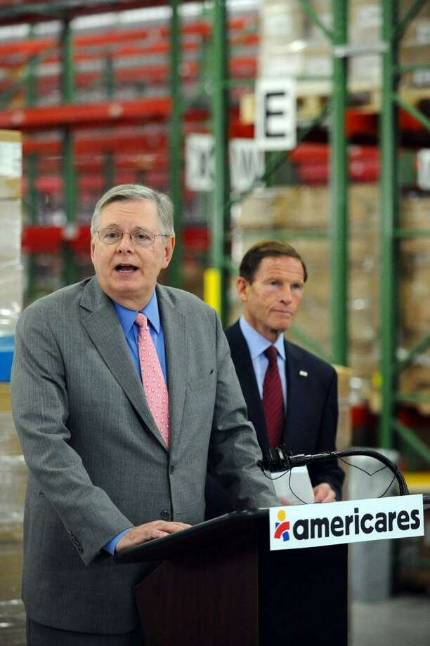 Stamford Mayor David Martin, left, speaks at the Americares global distribution center in Stamford, Conn. about the work being done to send aid to Haiti following Hurricane Matthew on Tuesday, Oct. 18, 2016. Also pictured is U.S. Senator Richard Blumenthal (D- Conn.). Photo: Michael Cummo / Hearst Connecticut Media / Stamford Advocate