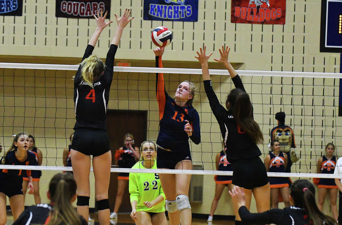 Seven Lakes junior outside hitter Danielle Batenhorst rises for a hit against Langham Creek Tuesday night. Batenhorst finished with a game-high 24 kills in the five-set victory.