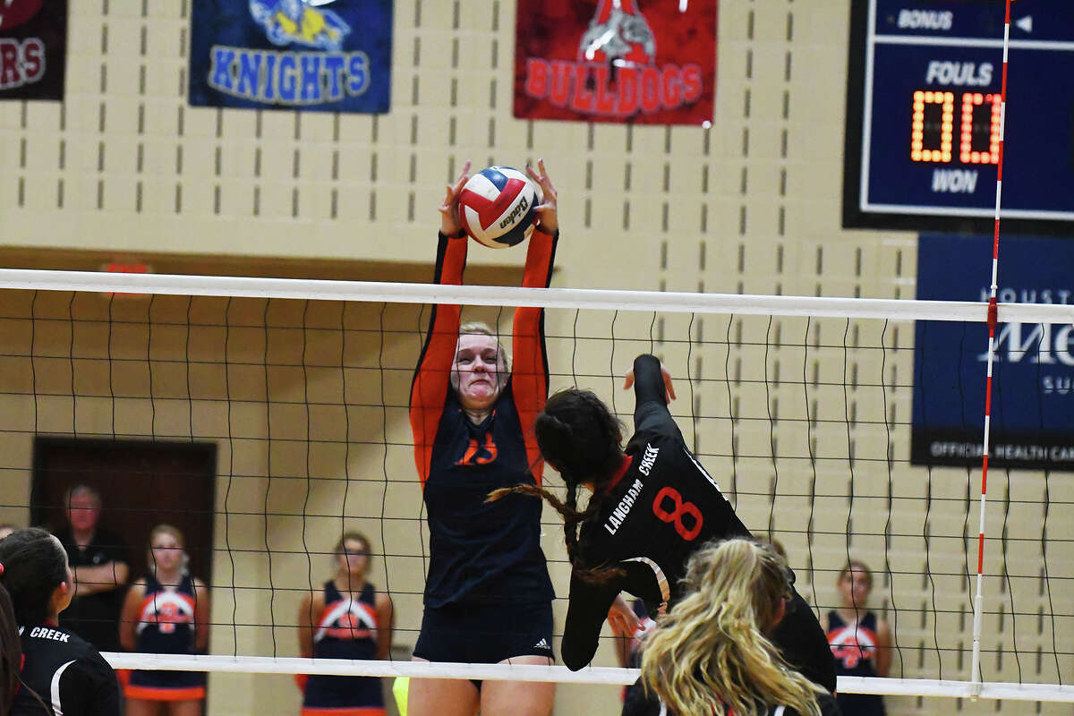 Langham Creek junior middle blocker Isabelle Wilkins attempts a hit against Seven Lakes Tuesday night. Wilkins enjoyed a terrific individual performance in the loss, finishing with 14 kills.