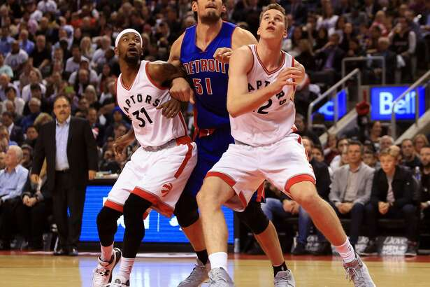 TORONTO, ON - OCTOBER 26:  Terrance Ross #31, Jakob Poeltl #43 of the Toronto Raptors and Boban Marjanovic #51 of the Detroit Pistons watch for a rebound during the first half of an NBA game at Air Canada Centre on October 26, 2016 in Toronto, Canada.  NOTE TO USER: User expressly acknowledges and agrees that, by downloading and or using this photograph, User is consenting to the terms and conditions of the Getty Images License Agreement.  (Photo by Vaughn Ridley/Getty Images)