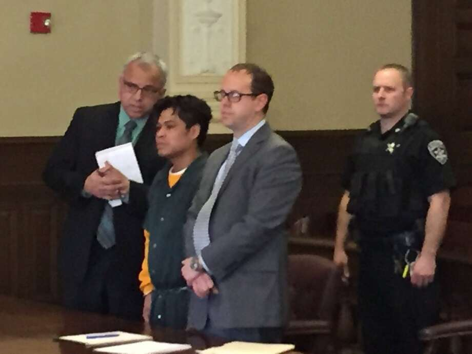 Cresencio Salazar, second from left, is arraigned on Thursday, Nov. 10, 2016, in Rensselaer County Court in the killings of Cristian Hernandez and Javier Gomez, whose bodies were found last month in Rensselaer County. (Kenneth C. Crowe II/Times Union)