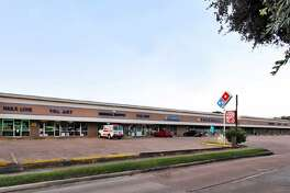 Braun Enterprises has purchased a shopping center at 1800 West 18th Street.