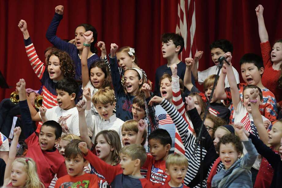 Students sing The Air Force Song during a Veterans Day event at the Brown School to honor local veterans and the families of those serving in the armed forces on Thursday, Nov. 10, 2016, in Schenectady, N.Y.   (Paul Buckowski / Times Union) Photo: PAUL BUCKOWSKI / 20038573A