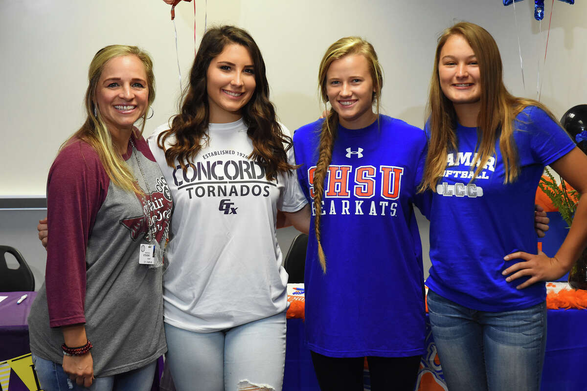 Cy-Fair Softball head coach Marissa Stevens flanks Simone Langland, Sheridan Fisher and Haley Moore, who will all represent the program at the next level.