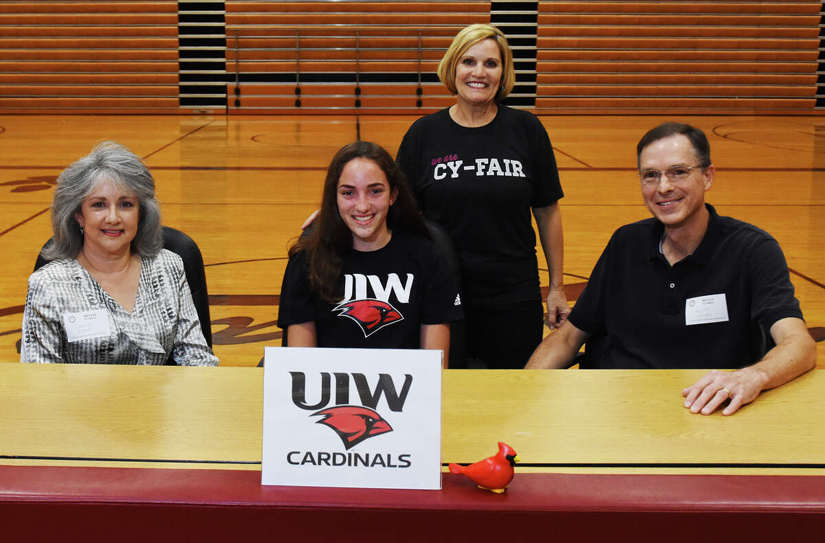 Cy-Fair's Olivia Noah signed to play for the University of the Incarnate Word Wednesday. She is pictured alongside her parents and head coach Ann Roubique.