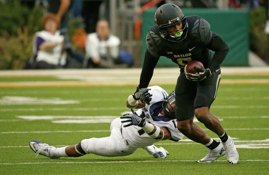 WACO, TX - NOVEMBER 5: Ranthony Texada #11 of the TCU Horned Frogs tries to stop KD Cannon #9 of the Baylor Bears after a catch in the first half at McLane Stadium on November 5, 2016 in Waco, Texas. (Photo by Ron Jenkins/Getty Images) Photo: Ron Jenkins, Stringer / 2016 Getty Images