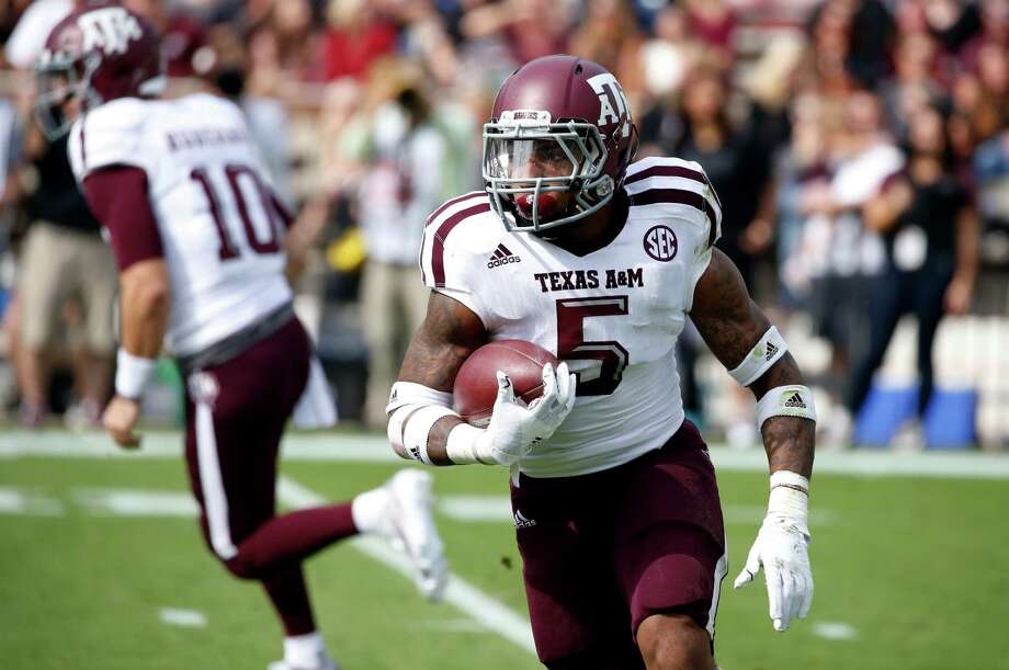 Texas A&M running back Trayveon Williams (5) looks for running room against Mississippi State in the first half of an NCAA college football game in Starkville, Miss., Saturday, Nov. 5, 2016. Mississippi State won 35-28. (AP Photo/Rogelio V. Solis) Photo: Rogelio V. Solis, STF / Copyright 2016 The Associated Press. All rights reserved.