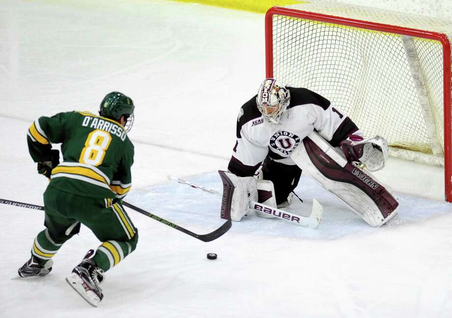Union goal tender Alex Sakellaropoulos (1) defends against Clarkson's Perry D'Arrisso (8) in the second period of an NCAA college hockey game Friday, Feb. 5, 2016, in Schenectady, N.Y., (Hans Pennink / Special to the Times Union) ORG XMIT: HP104 Photo: Hans Pennink / 10035304A
