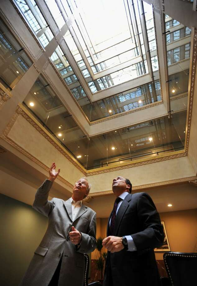 Owner Kim Morque, left, discusses the central atrium of the Spinnaker Building with Bridgeport Mayor Joe Ganim during a tour of the residential building at 1115 Main Street in Bridgeport, Conn. on Thursday, November 3, 2016. Photo: Brian A. Pounds / Hearst Connecticut Media / Connecticut Post