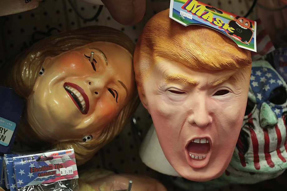Masks depicting Republican President-elect Donald Trump and Democratic presidential nomineeHillary Clinton are offered for sale at Fantasy Costumes. Photo: Scott Olson, Getty Images / 2016 Getty Images