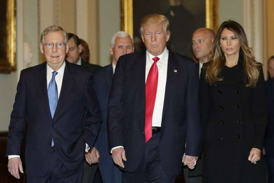 US President-elect Donald Trump (C) walks with his wife Melania Trump and Vice President-Elect Pence (2nd L) before a meeting with Senate Majority Leader Mitch McConnell(L) (R-KY) on Capitol Hill in Washington,DC on November 10, 2016. / AFP PHOTO / YURI GRIPASYURI GRIPAS/AFP/Getty Images Photo: YURI GRIPAS / AFP/Getty Images / AFP or licensors