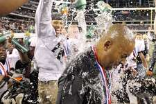 Steele Knights coach Mike Jinks is doused with water by players after his team defeated the Denton Guyer Wildcats in the Class 5A Division II state final 24-21 on Dec. 18, 2010, in Arlington.