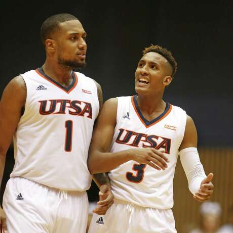UTSAÕs Gino Littles celebrates with UTSAÕs Jeff Beverly after Ark Tech missed a shot in closing seconds in UTSA-ArkTech opener on November 7, 2016 at UTSA Convocation Center. Photo: Ron Cortes, Freelance / For The San Antonio Express-News / Ronald Cortes / Freelance