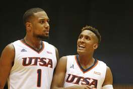 UTSA's Gino Littles celebrates with Jeff Beverly after ArkansasTech missed a shot in the closing seconds on Nov. 7, 2016, at the UTSA Convocation Center.