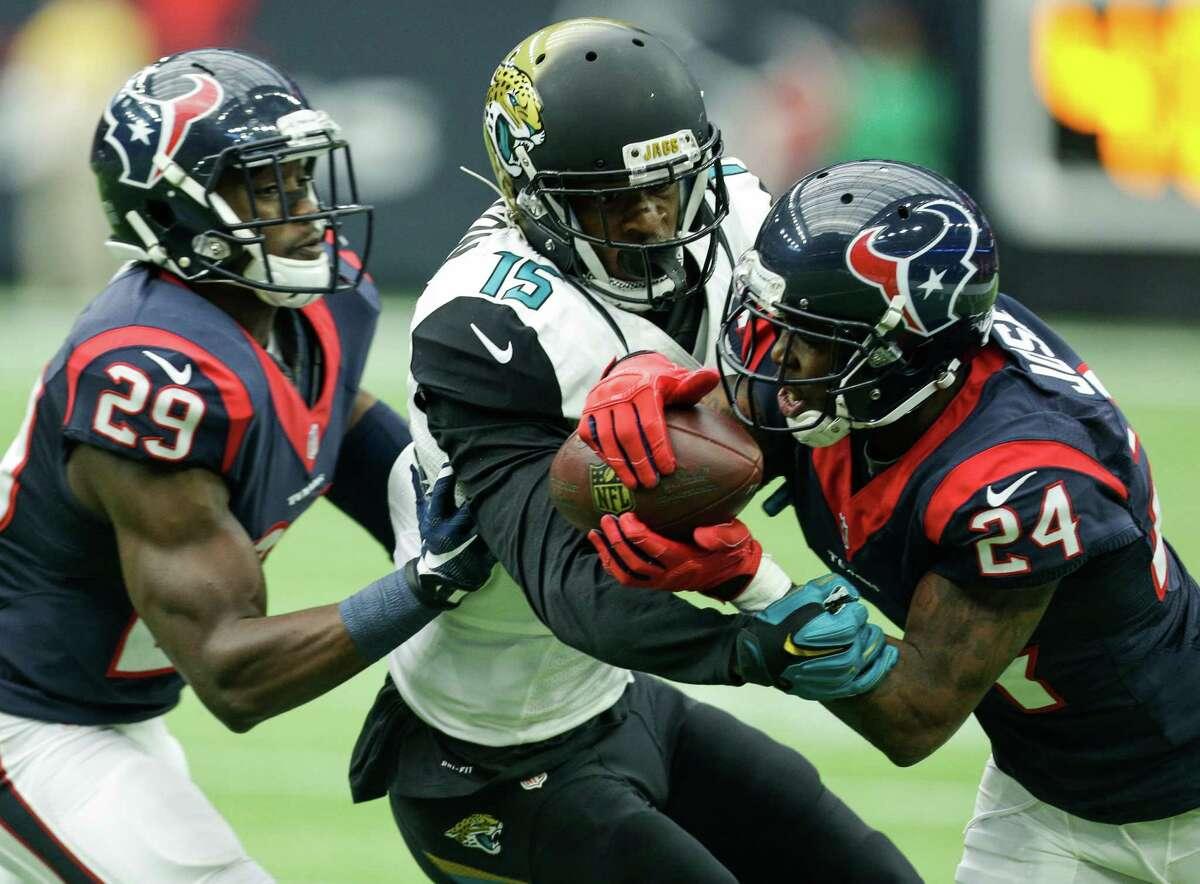 Houston Texans cornerback Johnathan Joseph (24) breaks up a pass intended for Jacksonville Jaguars wide receiver Allen Robinson (15) during the second quarter of an NFL football game at NRG Stadium on Sunday, Jan. 3, 2016, in Houston. ( Brett Coomer / Houston Chronicle )