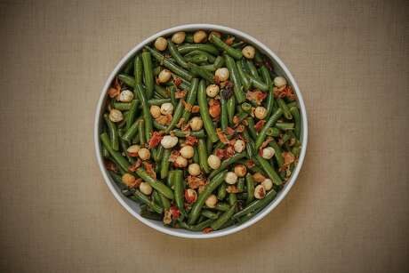 Green Beans with Hazelnut, Pancetta, and Carmelized Onions is seen on Wednesday, Nov. 9, 2016 in San Francisco, Calif.