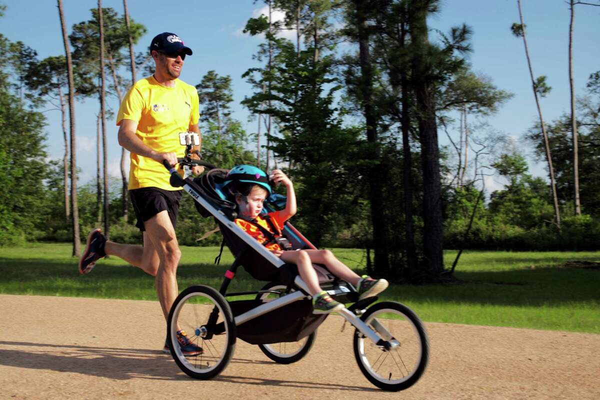 Calum Neff started running the park with a stroller when his oldest daughter was born in 2012. In February, he set a world record for fastest half marathon while pushing a stroller.