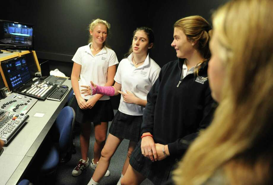 Sacred Heart broadcast students Lily Brown, left, Margo Muccia, center, and Catherine Hamilton give a tour of the facilities before the Inside Broadcast Journalism presentation at Sacred Heart Greenwich in Greenwich, Conn. Thursday, Nov. 10, 2016. Sacred Heart parents toured the state-of-the-art broadcast facility and listened to student and professional panelists speak about their experiences in the broadcast program. Melanie Bloom, wife of the late NBC News Correspondent David Bloom, delivered the keynote speech. Photo: Tyler Sizemore / Hearst Connecticut Media / Greenwich Time