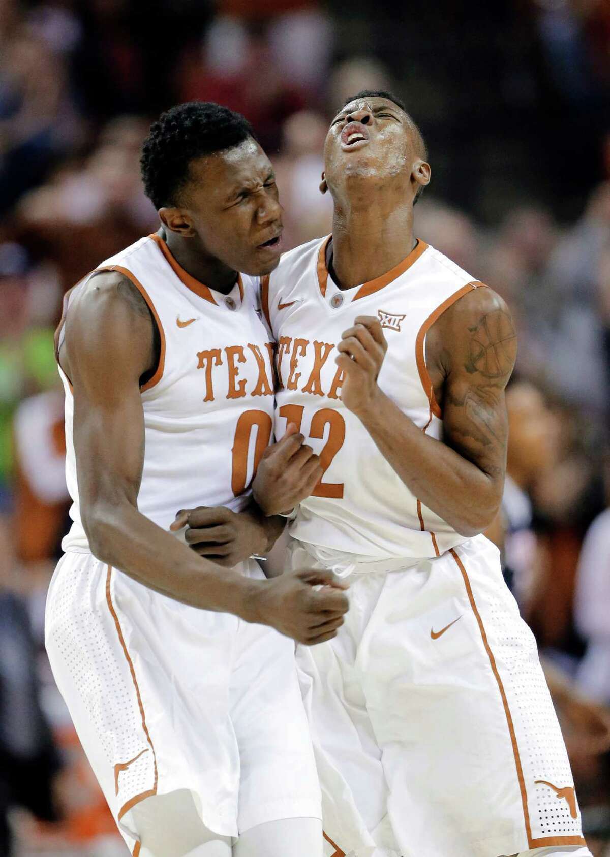 Texas guards Tevin Mack (0) and Kerwin Roach Jr. (12) celebrate during the first half of an NCAA college basketball game against Connecticut, Tuesday, Dec. 29, 2015, in Austin, Texas. (AP Photo/Eric Gay)