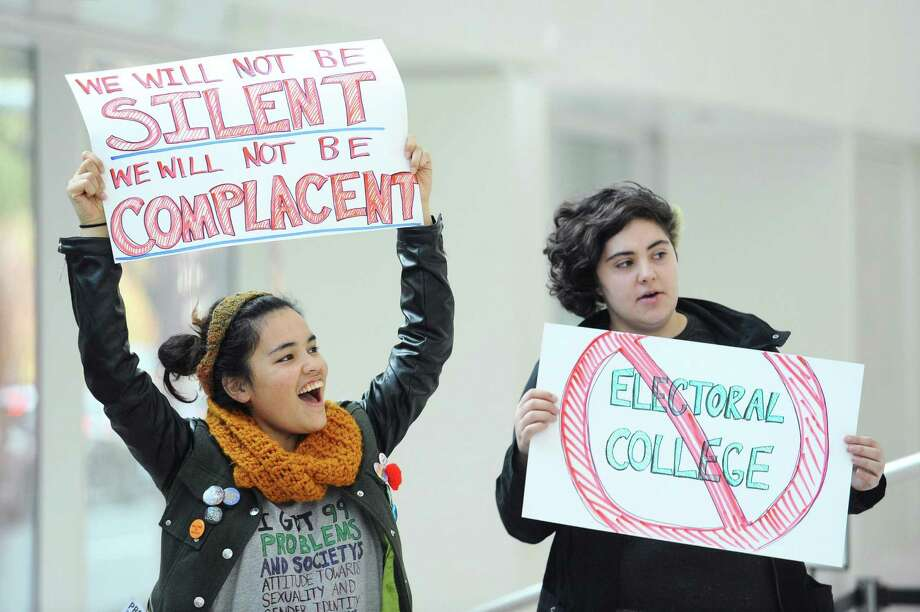 19-year-old Nina Drozdenko, left, and 23-year-old Alex Manna cheer on a speaker during the anti-Trump, anti-system demonstration inside UConn Stamford in Stamford. Photo: Michael Cummo / Hearst Connecticut Media / Stamford Advocate