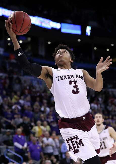 OKLAHOMA CITY, OK - MARCH 20:  Admon Gilder #3 of the Texas A&M Aggies makes a layup to tie the game with a score of 71 to 71 to bring them into overtime against the Northern Iowa Panthers during the second round of the 2016 NCAA Men's Basketball Tournament at Chesapeake Energy Arena on March 20, 2016 in Oklahoma City, Oklahoma.  (Photo by Ronald Martinez/Getty Images) Photo: Ronald Martinez, Staff / 2016 Getty Images