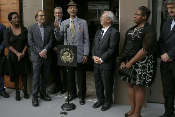 Co-chair of Homeless Coordinating Board and veteran Dell Seymour (wearing hat) and Mayor Ed Lee announce 33 dedicated units for chronically homeless veterans at 528 Valencia St. on Thursday, November 10, 2016, in San Francisco, Calif.