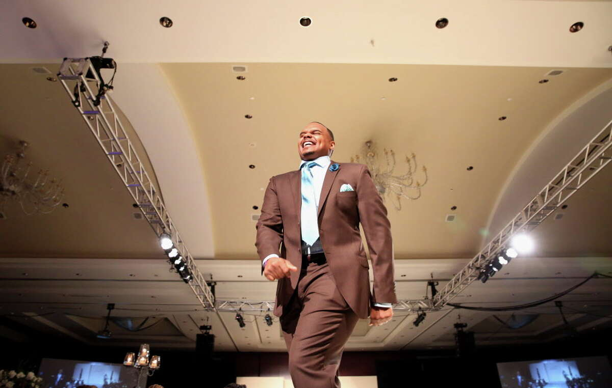 Former Houston Texans player Chester Pitts walks on the runway at Una Notte in Italia benefitting Bo's Place presented by Festari for Men at Royal Sonesta Friday, Nov. 4, 2016, in Houston.