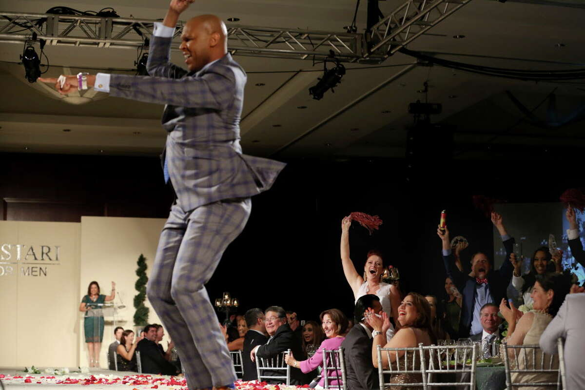 Crowds react to Travis Torrence's dance at Una Notte in Italia benefitting Bo's Place presented by Festari for Men at Royal Sonesta Friday, Nov. 4, 2016, in Houston.