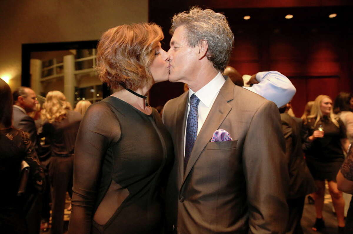 Dominique Sachse and Nick Florescu have a kiss at Una Notte in Italia benefitting Bo's Place presented by Festari for Men at Royal Sonesta Friday, Nov. 4, 2016, in Houston.