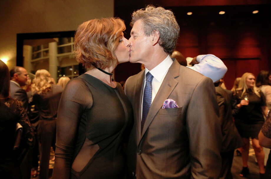 Dominique Sachse and Nick Florescu have a kiss at Una Notte in Italia benefitting Bo's Place presented by Festari for Men at Royal Sonesta Friday, Nov. 4, 2016, in Houston. Photo: Yi-Chin Lee, Houston Chronicle / © 2016  Houston Chronicle