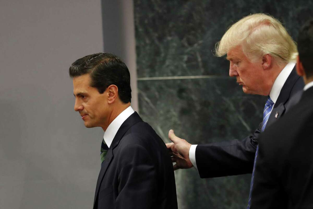 Republican presidential nominee Donald Trump walks with Mexico's President Enrique Pena Nieto at the end of their joint statement at Los Pinos, the presidential official residence, in Mexico City during Trump's visit there in August. Trump's incendiary proposals to heavily tax Mexican exports to the United States, deport millions of Mexican and other immigrants, and build a solid border wall has caused a lot of concern among those whose livelihoods depend on trade with Mexico.