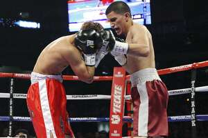 Richard Hernandez (left) is hit by Adam Lopez during the first round of their bantamweight fight on Feb. 4, 2012 at the Alamodome. Lopez won by TKO in the first round.