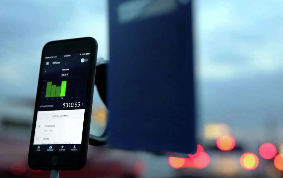 Uber drivers long on via smartphone, and pick up willing riders. The arrangement has upended the cab market in Houston, and led to disagreements about the best way to ensure rider safety. Photo: Yi-Chin Lee, Houston Chronicle / © 2016  Houston Chronicle
