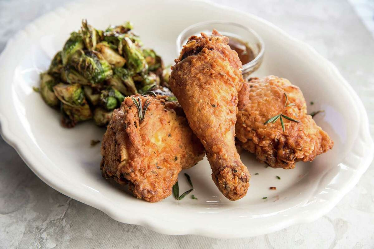 Relish Restaurant & Bar , 2810 Westheimer, 713-599-1960; relishhouston.comShown: Fried chicken served with hot honey and maple bacon Brussels sprouts at Relish Restaurant & Bar in Houston.