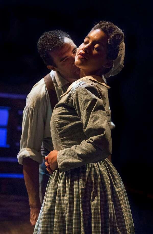 "Frank (Lance Gardner) and Clarissa (Dezi Soléy) share an intimate moment in Aurora Theatre Company's ""Safe House."" Photo: David Allen, Aurora Theatre Company"