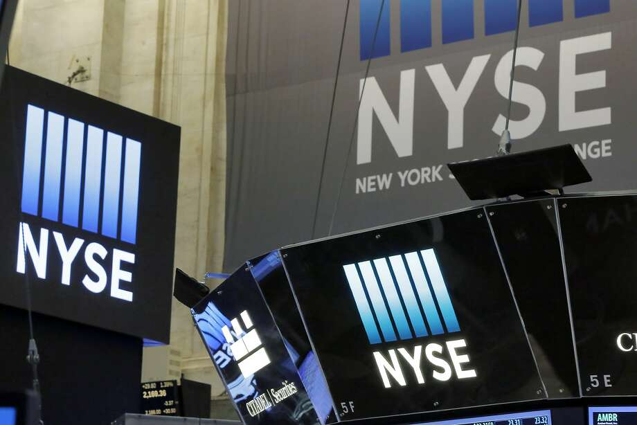 The top of a trading post and an NYSE banner above the trading floor of the New York Stock Exchange are seen Wednesday. Photo: Richard Drew, Associated Press